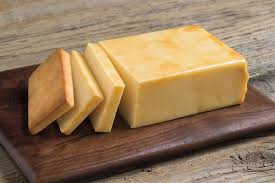 SMOKEY CHEDDAR CHEESE, PER POUND OR SLICE